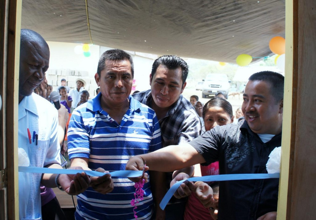 Ribbon cutting ceremony at the Computer Lab…  Pictured from left to right is  Principal, Geraldo Baltazar; Committee Secretary, Marvin Coc; Alcalde, Juan Choc and Village Chairman, Andres Coh;  Not pictured but instrumental in setting up the lab is Peace Corps Volunteer Meredith Casper of Akron, Ohio.