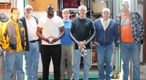 The Loading team from left to right:  Owens CC volunteers Morisey and Pascal Hessou (first and third from left): Rotary Club of Sylvania volunteers Mike Tansey, Baron Black, Bill Miller, and Rotary Club of Baltimore volunteer Gary Davis and his friend Tim.  Not pictured… Mel Honig (Rotary Club of Sylvania and photographer).  This was first time loading for Morisey, but everyone else has helped on more than one occasion.
