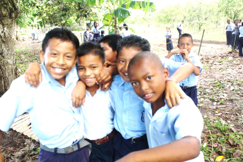 Students at the Pomona Primary School… behind is their school garden