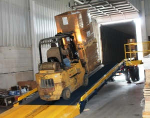 North Baltimore Rotarian Gary Davis loading the container using the newly purchased portable ramp.