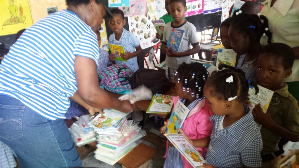 Children checking out books (these were donated by Books-4-Buddies) during Mission 2. Books are perhaps the most important resource that RCI brings to the primary schools of Jamaica and Belize.