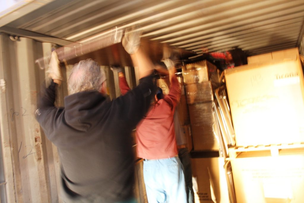Keith, Jerry Peacock and Randy help load tables wherever we could fit them.  In the back and barely visible is Leon Duffus, ESOL student from Jamaica who directed much of the loading.  It was a tight fit but everything went smoothly.