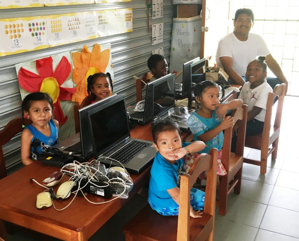 Mario with children after setting up computers in Punta Gorda Town, Toledo District.