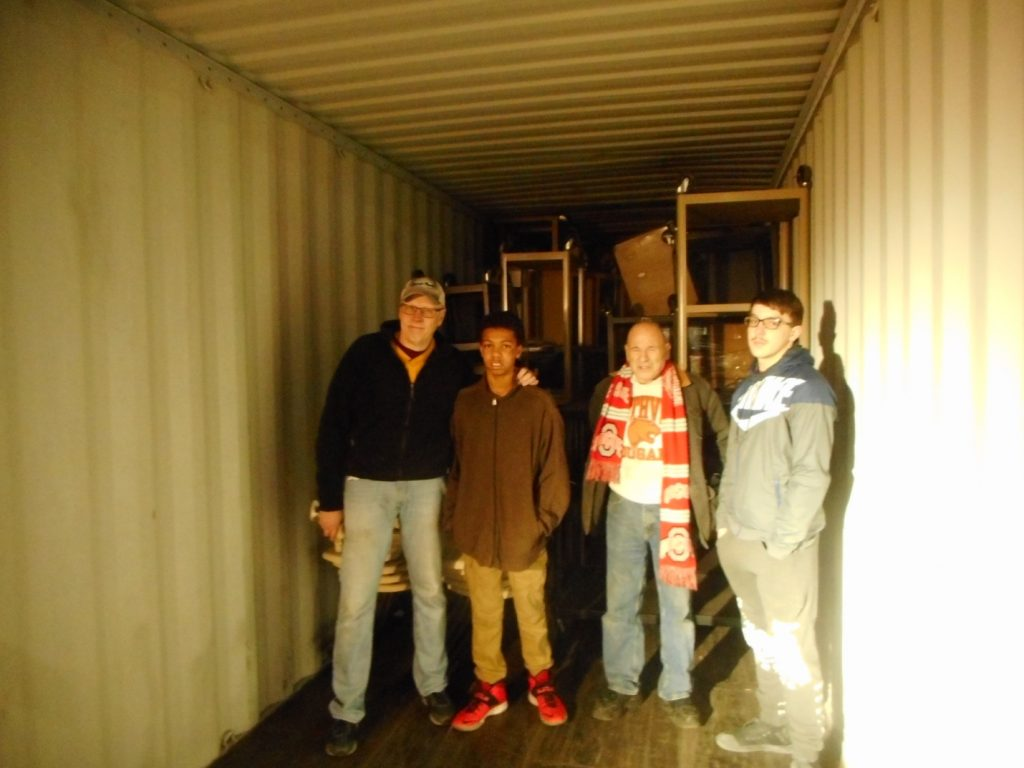 Every mission begins with collecting... educational equipment, funding and a mission team.  Next is to get the product to the distribution point in Belize.  Shown here are volunteers loading the 40 foot container.