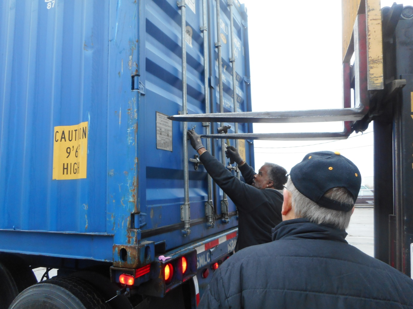 The container is filled to the brim.  There was some extra room so some medical equipment was used to fill out the load and with the help of the fork lift the doors were closed and sealed.