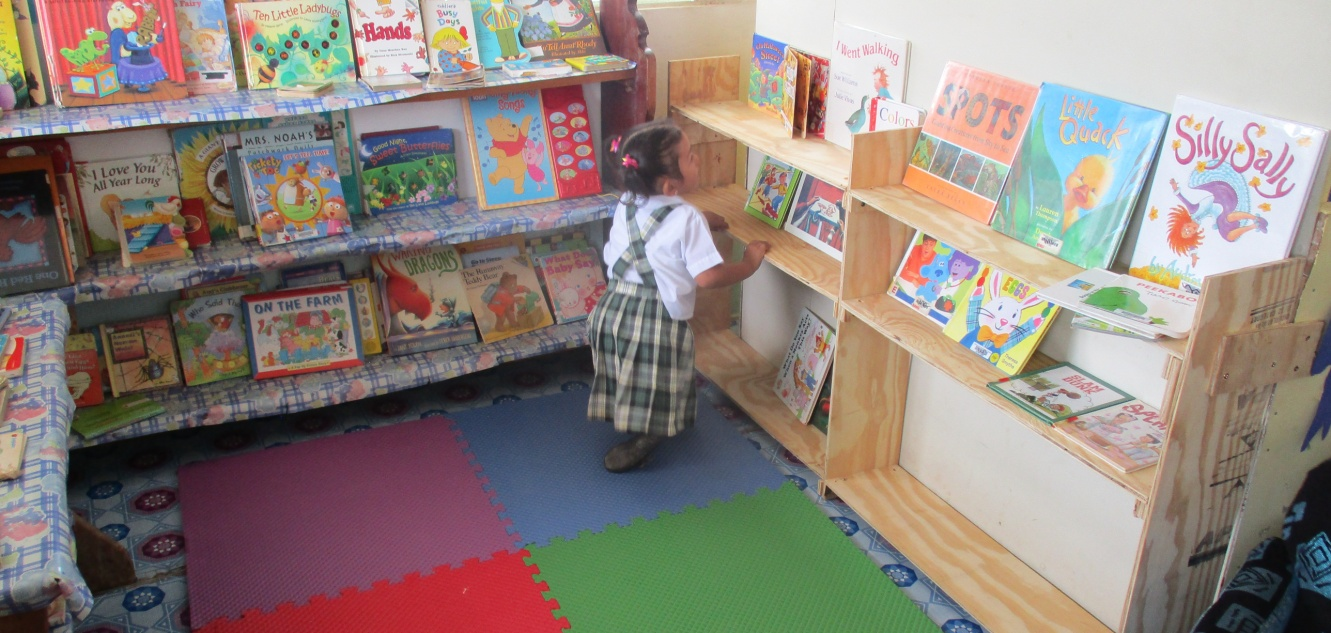 I watched as this young lady carefully examined each book. She would take one, leaf through it and then place it on the bookshelves we just built. She was still doing this when we left for another school. I asked her teacher about this young lady… and she said 'she loves books and reading and is not surprised by her interest/dedication'.