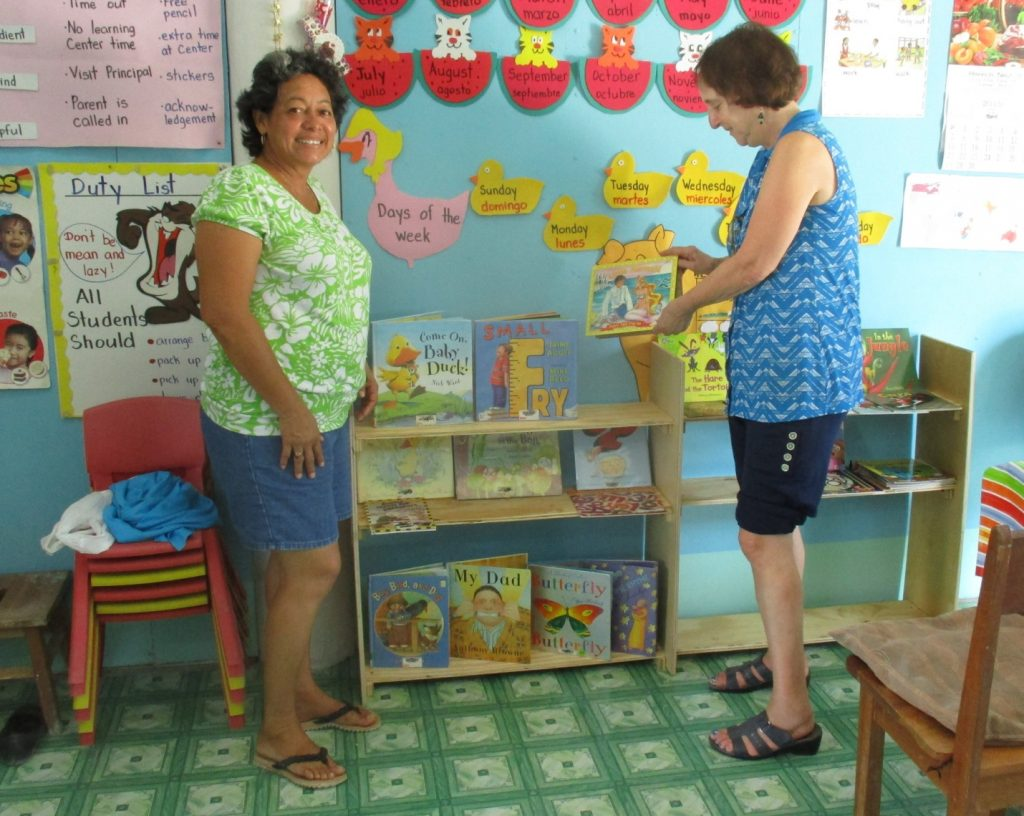 Non Rotarian Karen Marinoff (on the right), is our pre-school educator professional and worked with the preschool teachers and students. Here she is setting up the library and the sharing teaching techniques. Karen, now retired, has previously owned pre-schools and has taught in the pre-school education program at the local community college.